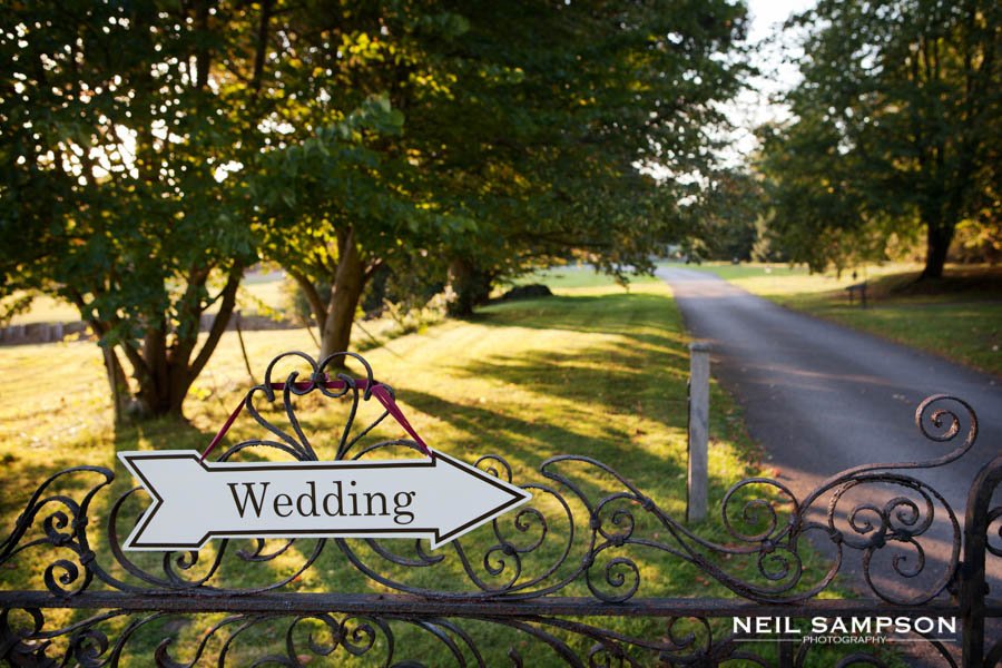 A sign points the way to the wedding