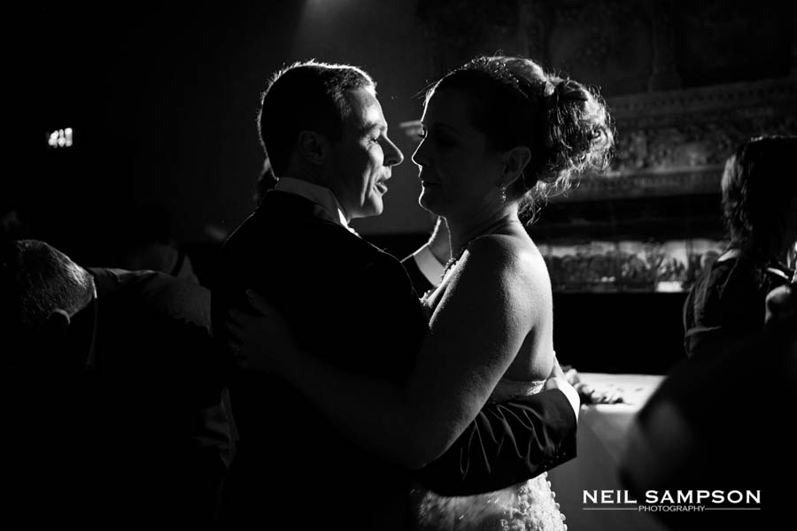 Hertfordshire Wedding Photography sees the bride and groom are silhouetted by rim light during their first dance