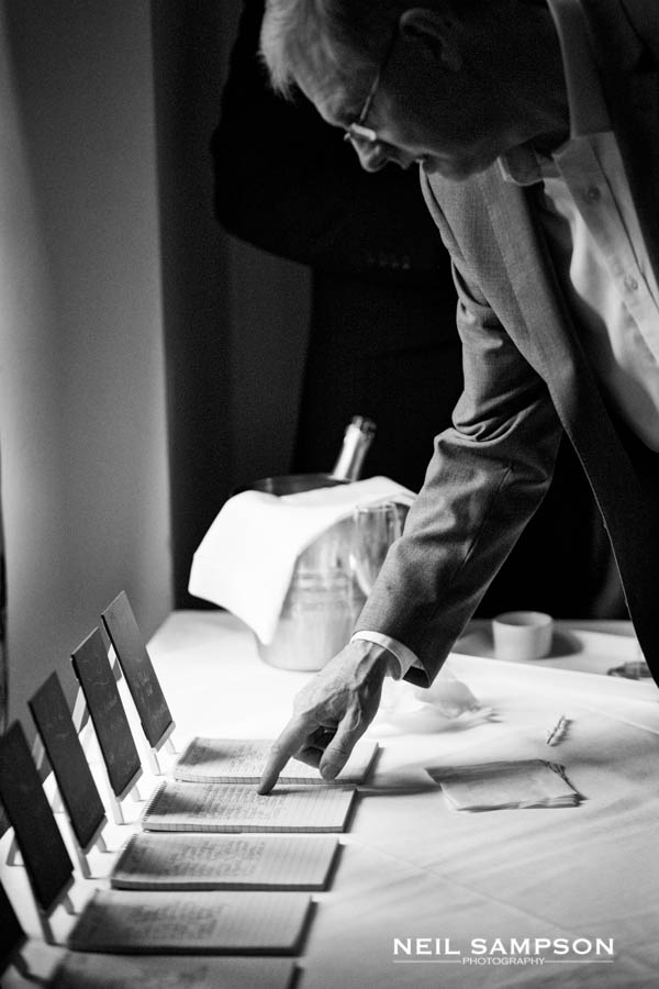 A guest looks through the table plans before the meal at Grim's Dyke hotel