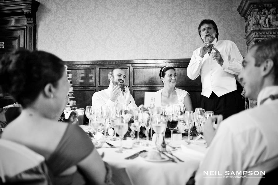 The father of the bride asks for quiet during a funny moment in his speech