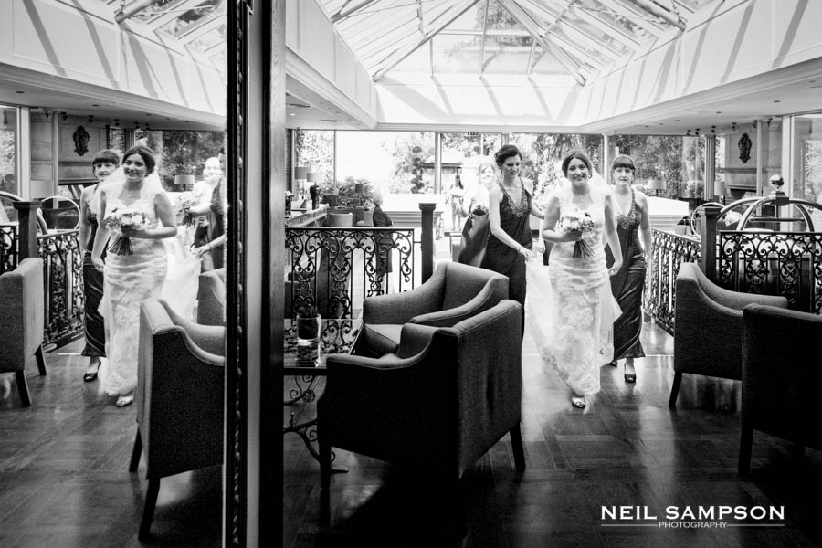 The bride arrives ahead of her wedding at Sopwell house and is reflected in a large mirror