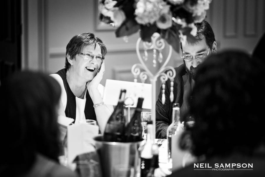 A guest smiles widely during the meal at Sopwell House Hotel in Hertfordshire