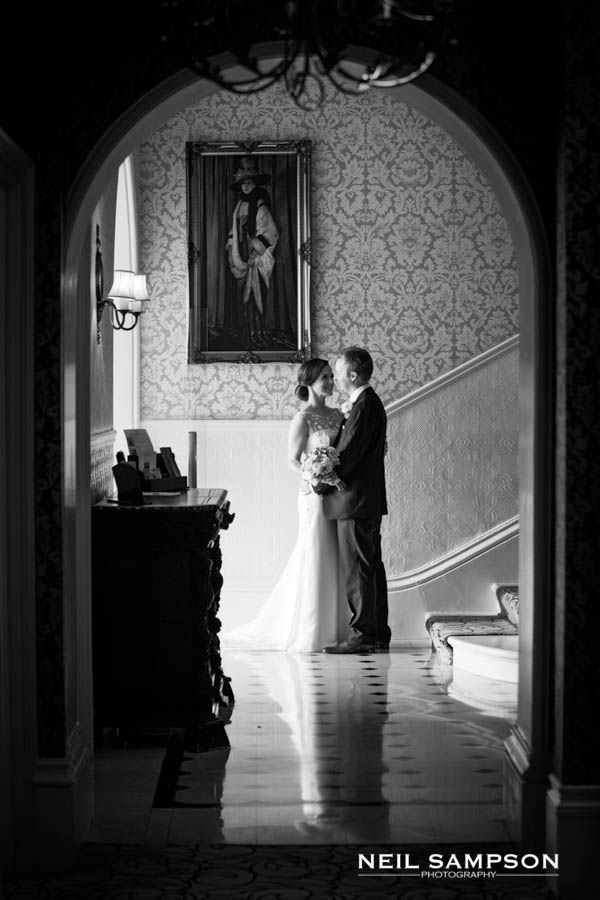 Bride & Groom by stairs at Petersham Hotel in Richmond