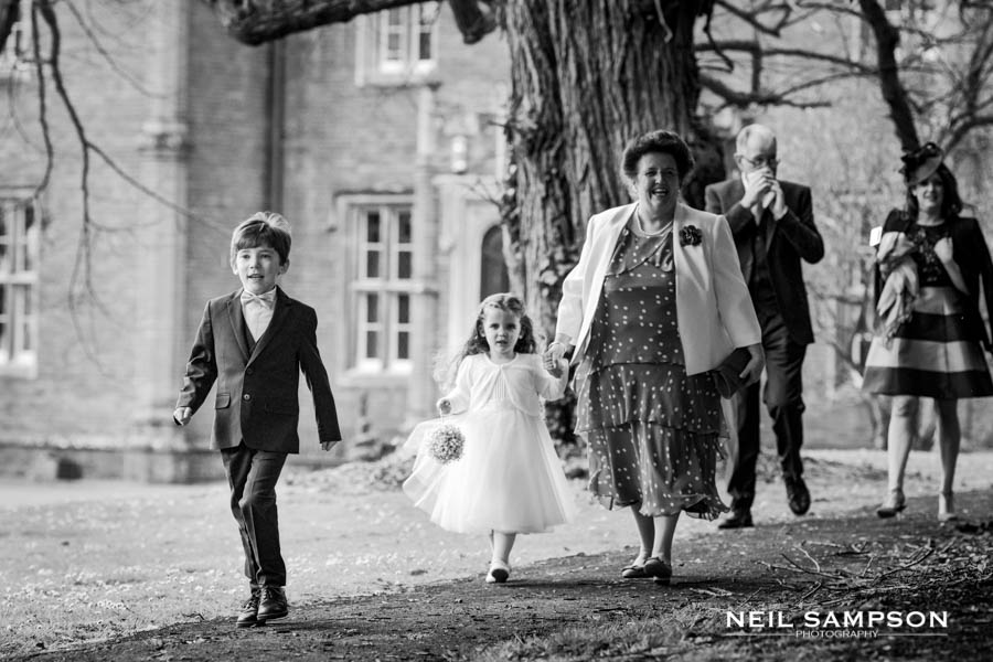 Guests including the page boy and flower girl walk to latimer church