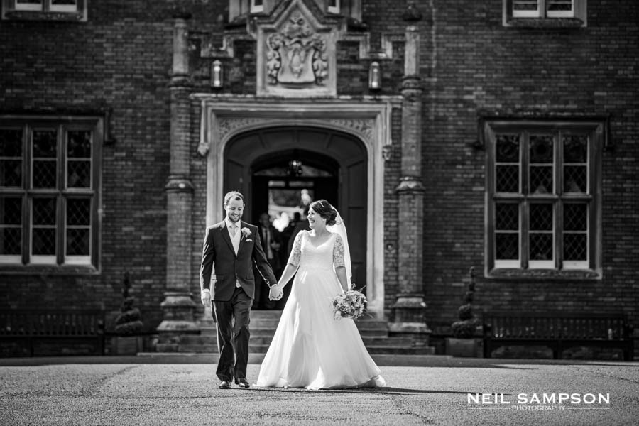 A bride and groom in black and white at a wedding at Latimer Place in Buckinghamshire