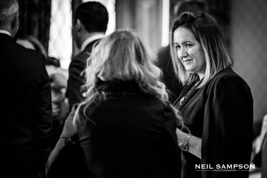 Two ladies chat during the drinks reception at a wedding at Latimer Place in Buckinghamshire