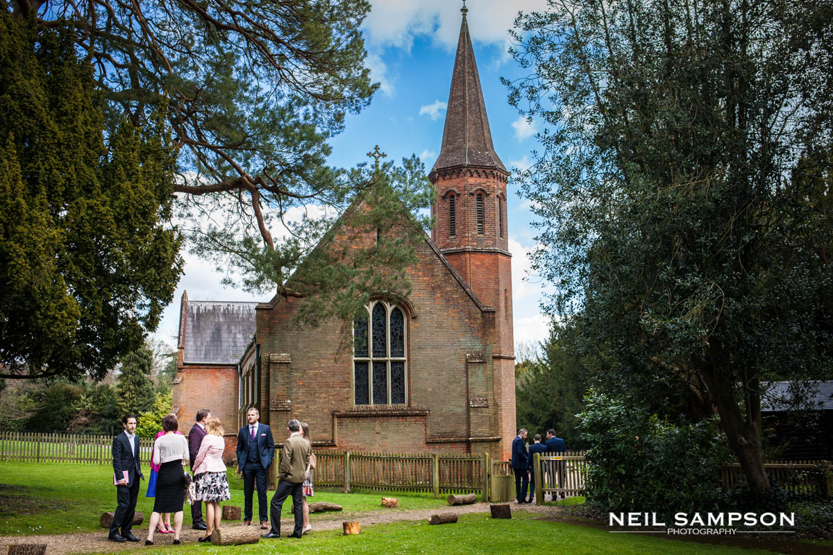 Guests gather outside Latimer Church before the wedding