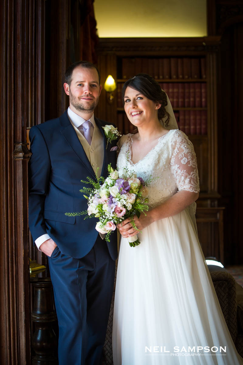 The newly married couple in the library at Latimer Place