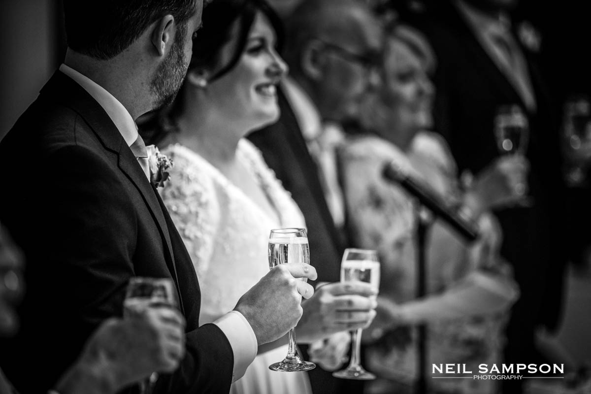 A toast to the bride and groom at a Latimer Place wedding
