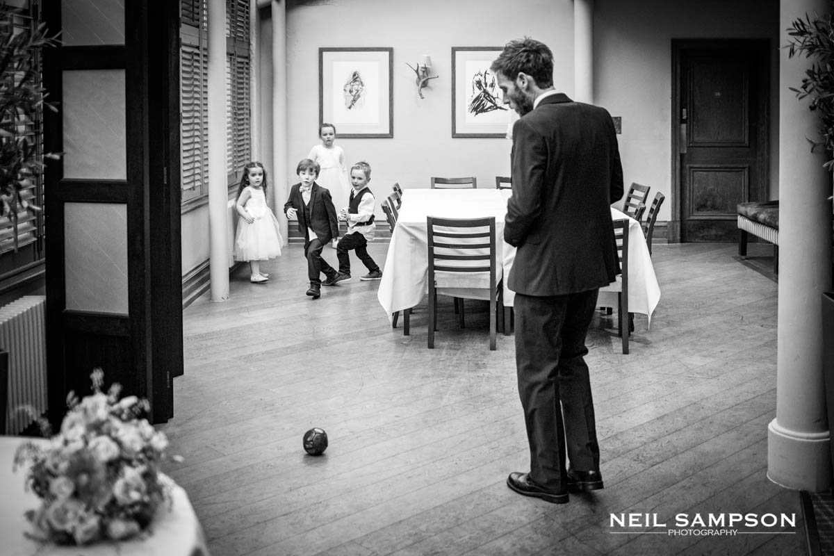 Kids play football indoors during the reception at Latimer Place in Buckinghamshire