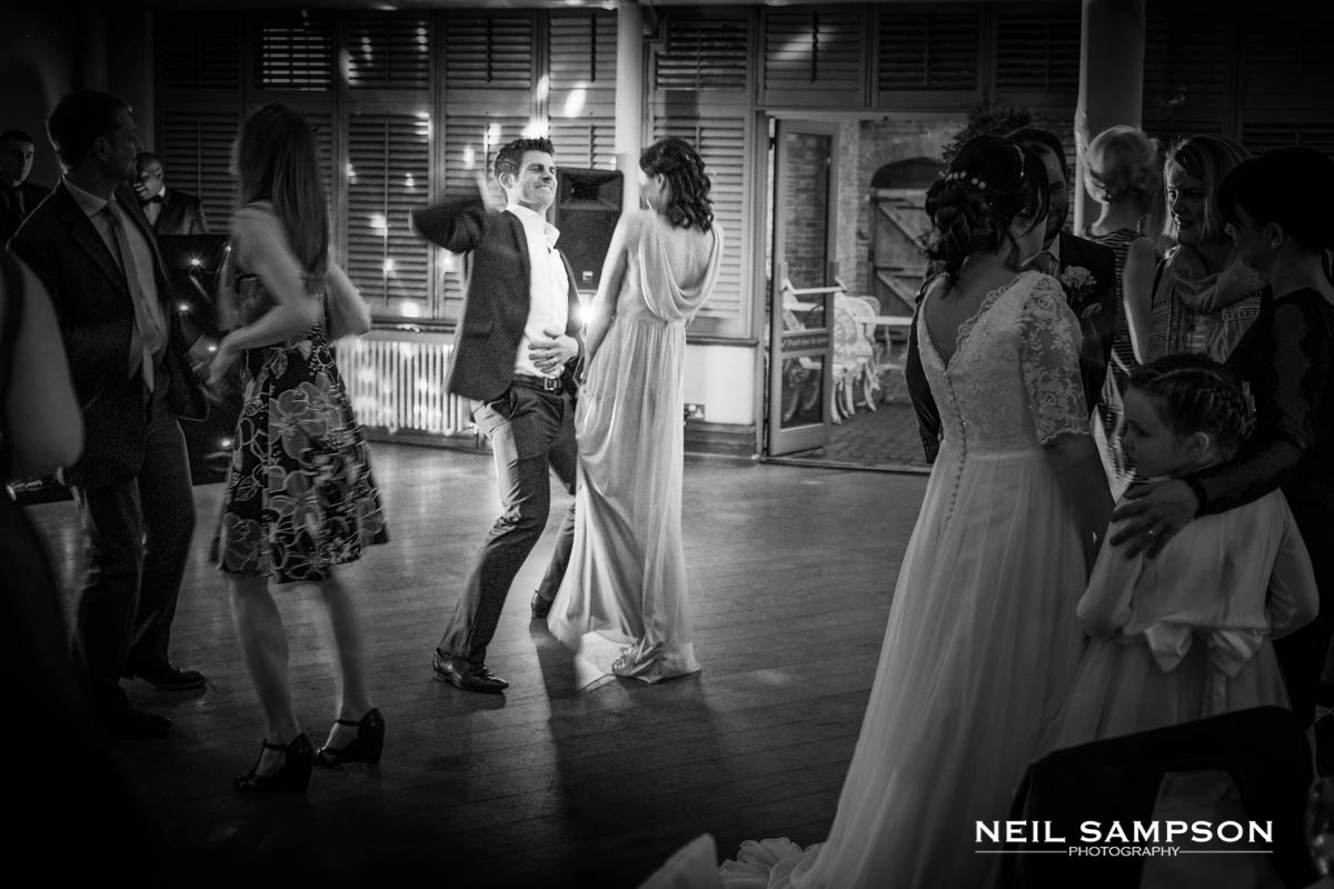 Guests dance at a Latimer Place wedding in Buckinghamshire