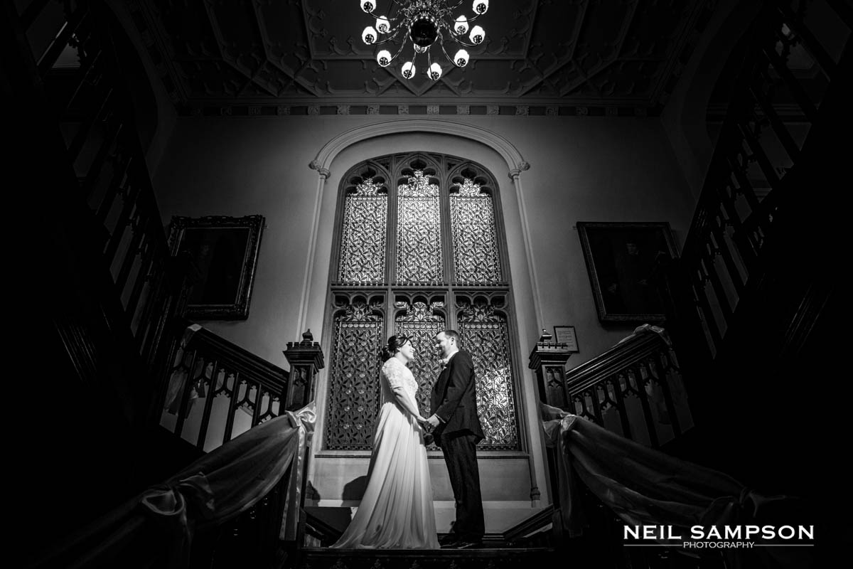 A Latimer Place wedding where the bride and groom hold hands on the stairs