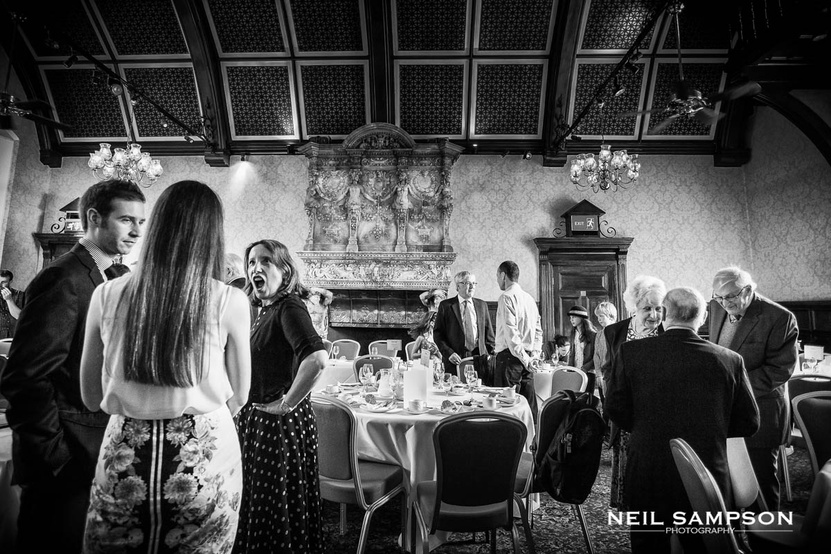 groups of guests gather in the music room at grims dyke hotel