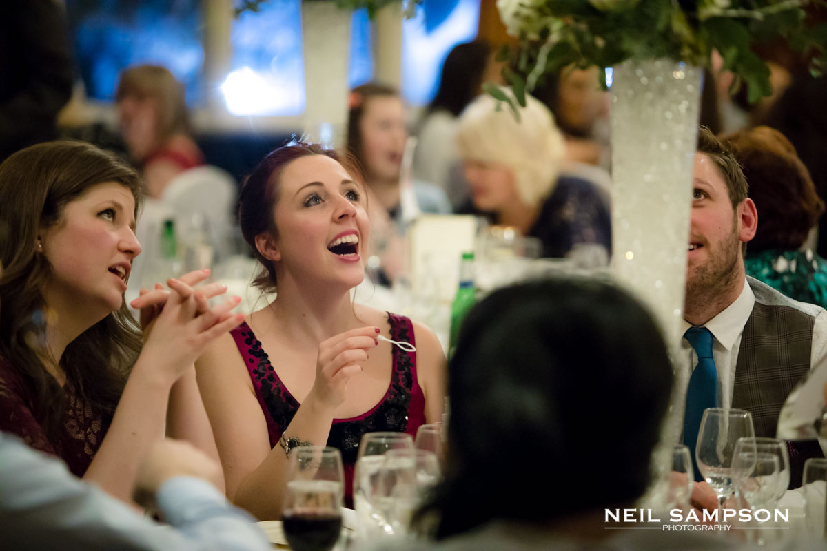 Guests laugh as they blow bubbles