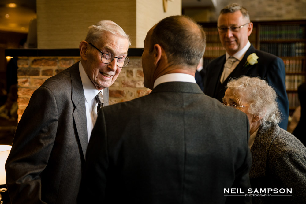 Elderly guests chat in the reception at shendish manor hotel