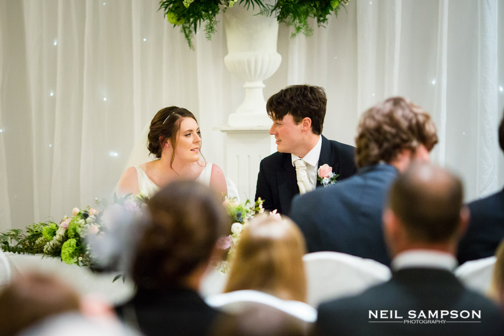 The newly weds talk while signing the register