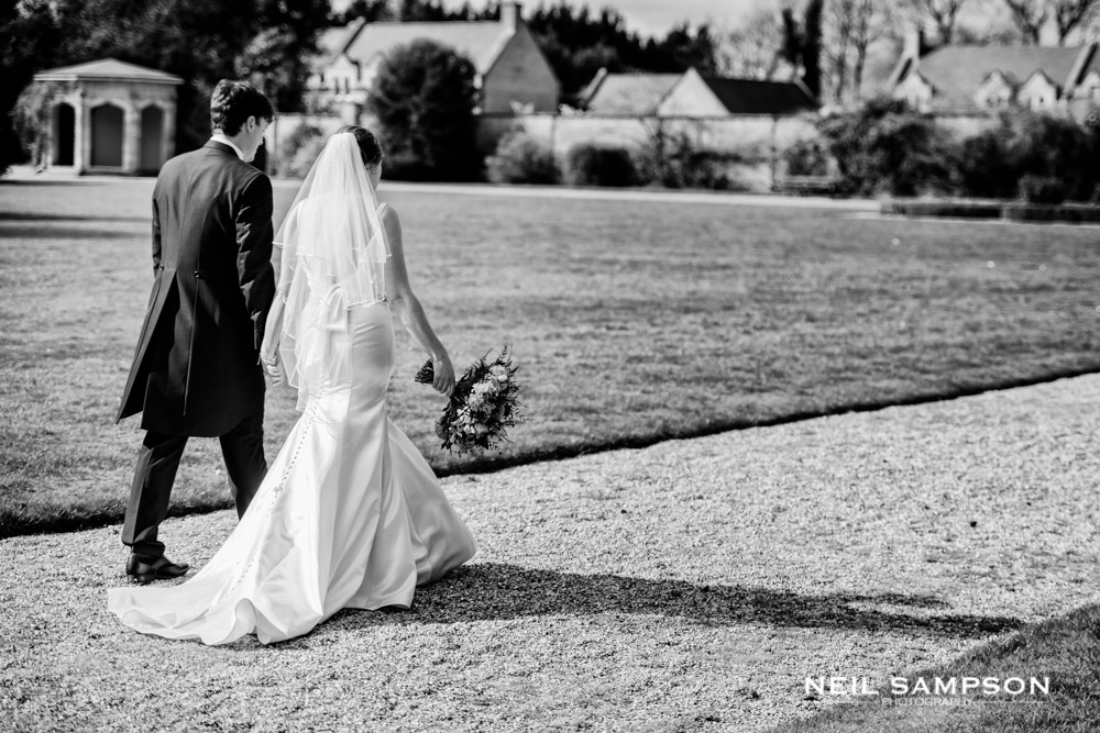 The bride and groom walk together through the grounds at Shendish Manor