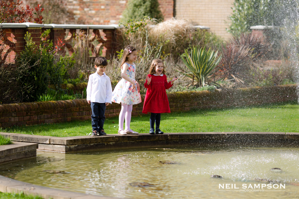 Three small children look at the water feature at Shendish Manor hotel