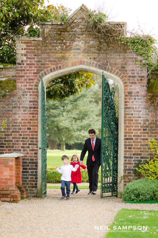 A father and two small children explore the gardens at Shendish Manor