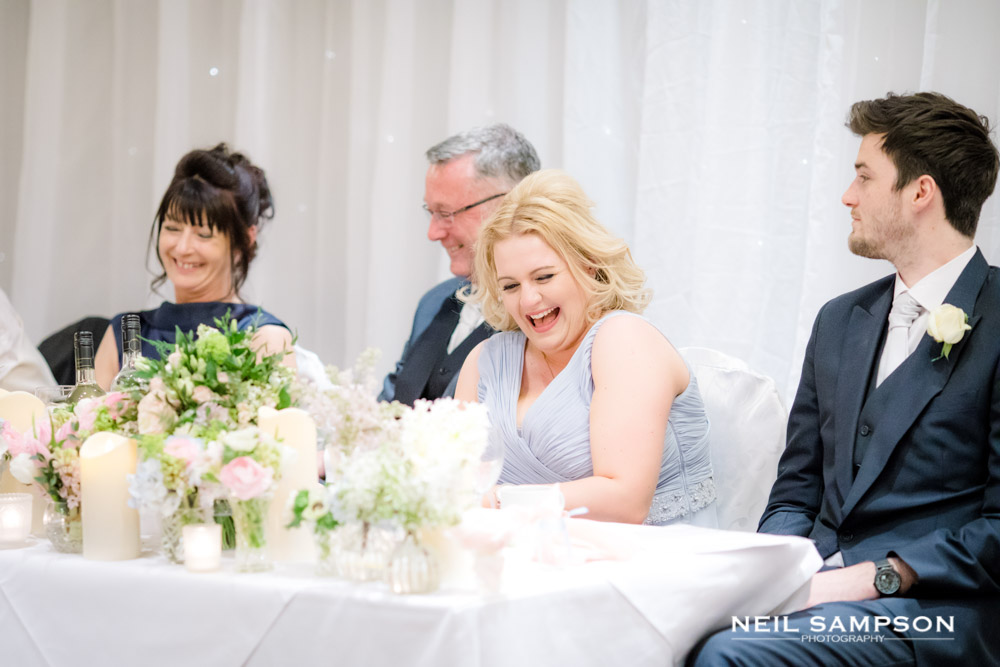 One of the bridesmaids enjoying the speeches