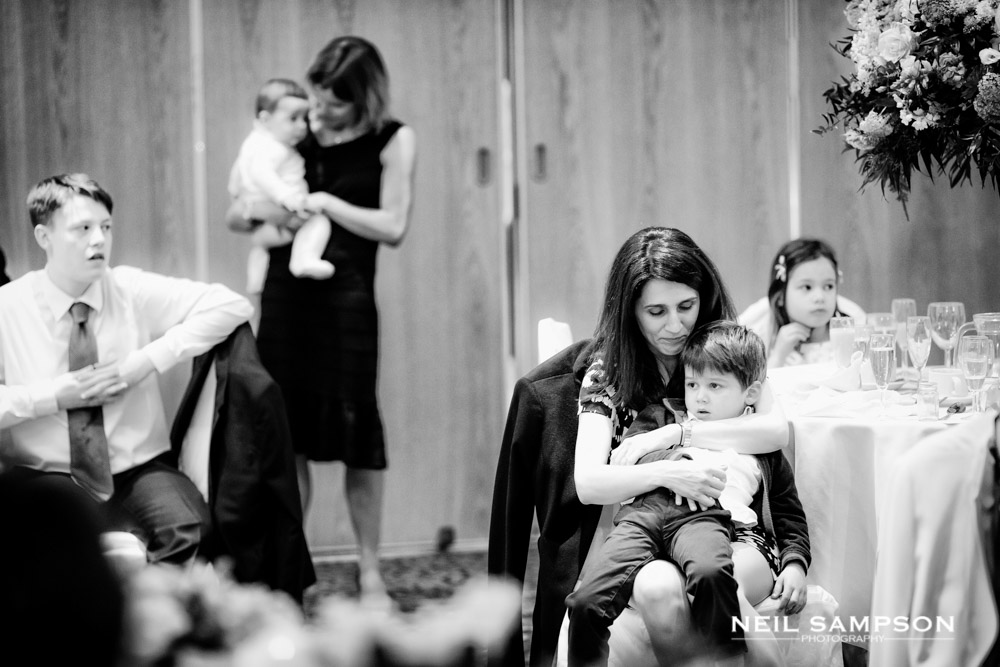 Guests with young children at a wedding reception