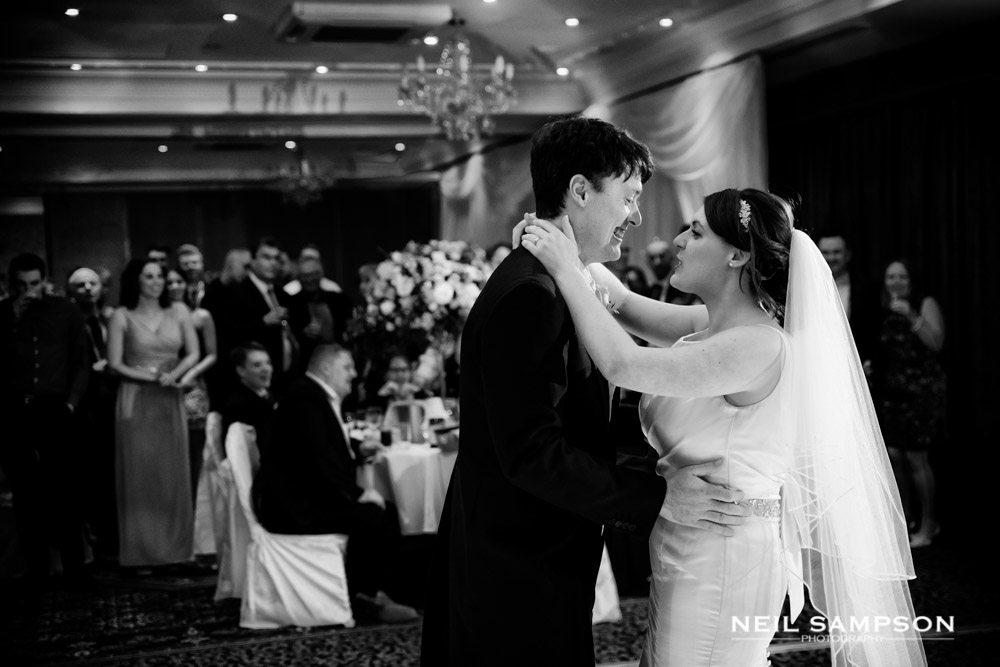 The guests look on as the bride and groom enjoy their first dance at Shendish Manor in Hemel Hempstead