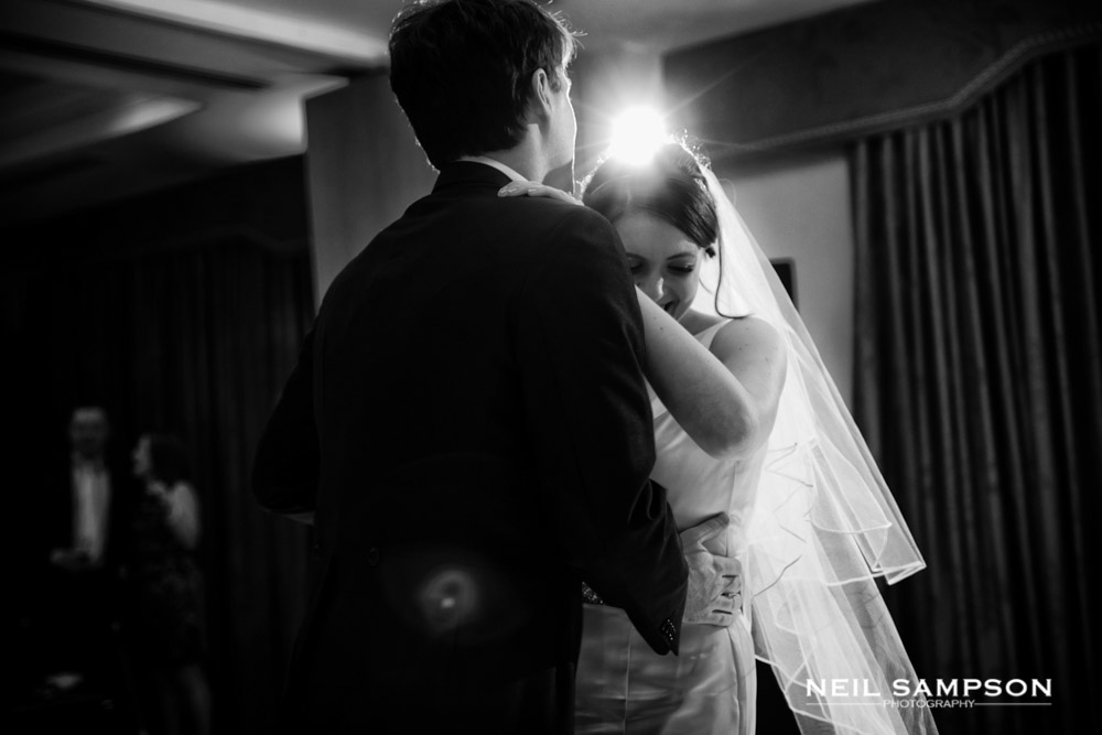 The bride is backlit during the first dance at Shendish Manor
