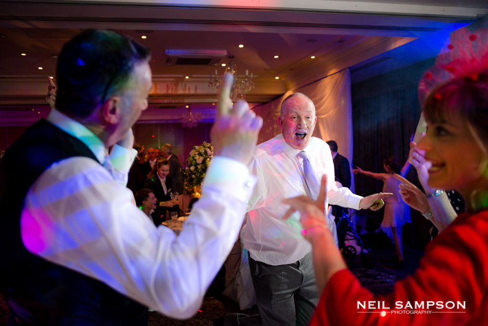Guests pointing while dancing to an old song