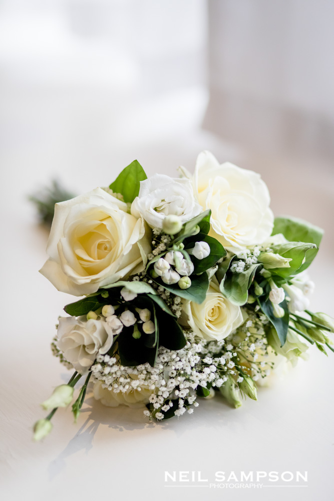 A green and white bridal bouquet