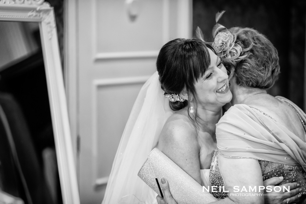 The bride embraces a female relative