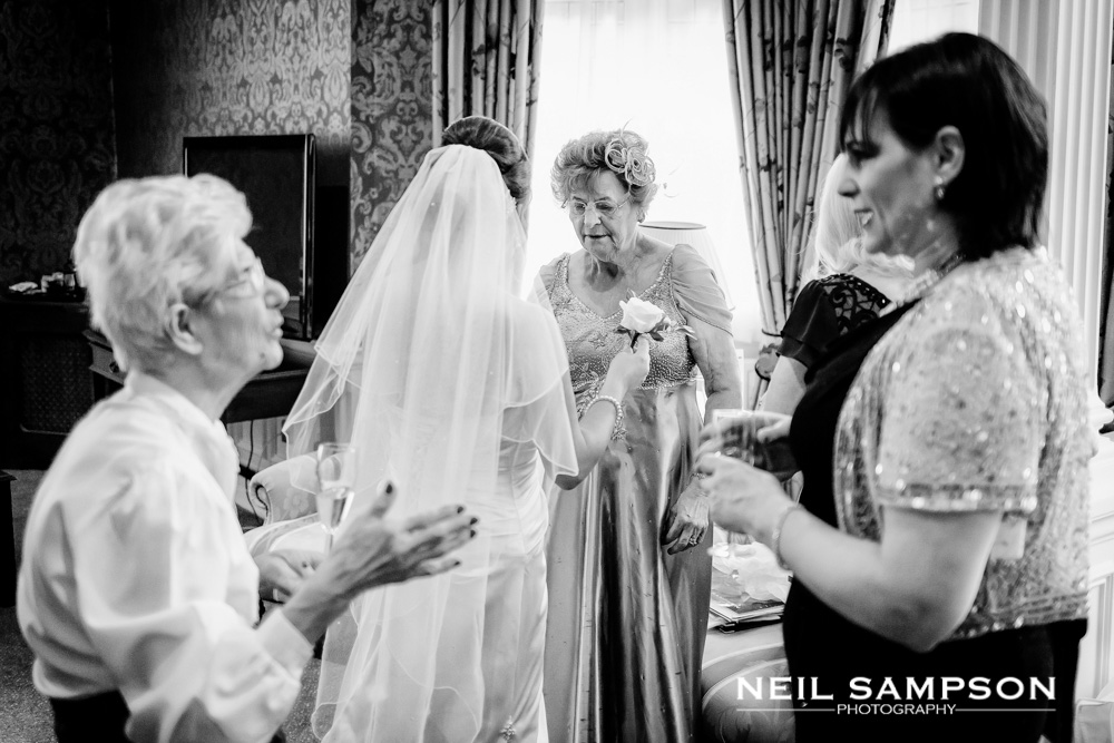 Wedding day preparations in the bridal suite at grims dyke hotel