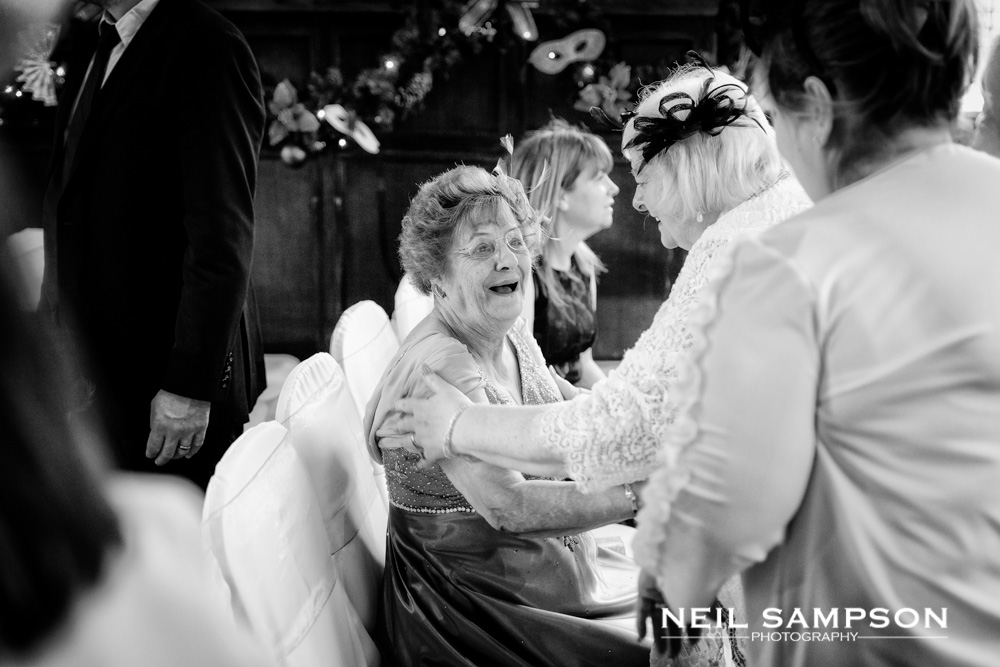 The bride's family laugh before the ceremony