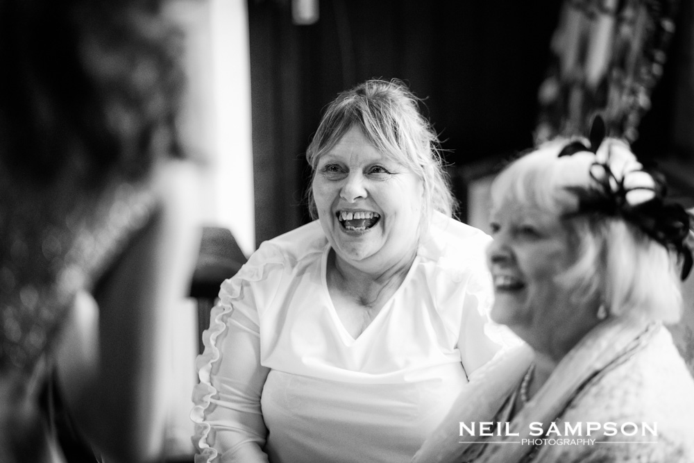 Guests laugh during the drinks reception