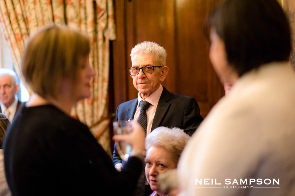 A guest looks on during the drinks reception in grims dykes drawing room