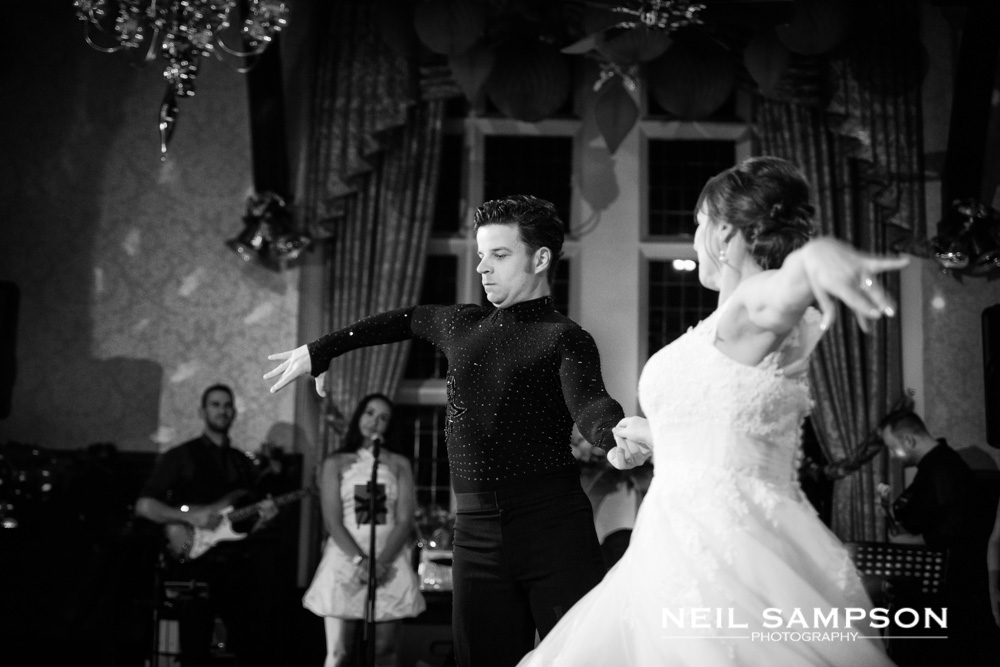 The bride and groom dance