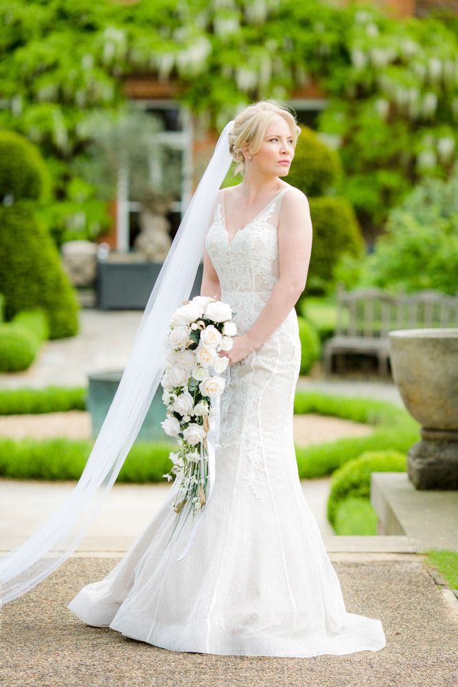 A classic pose of a bride at The Grove in Watford