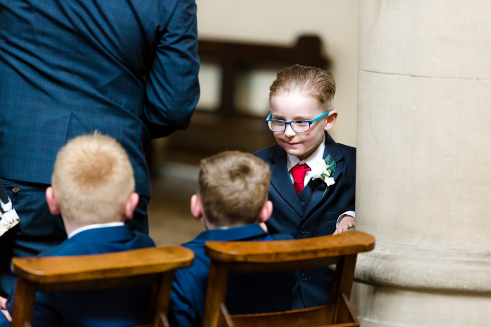 Young boys talk during a wedding