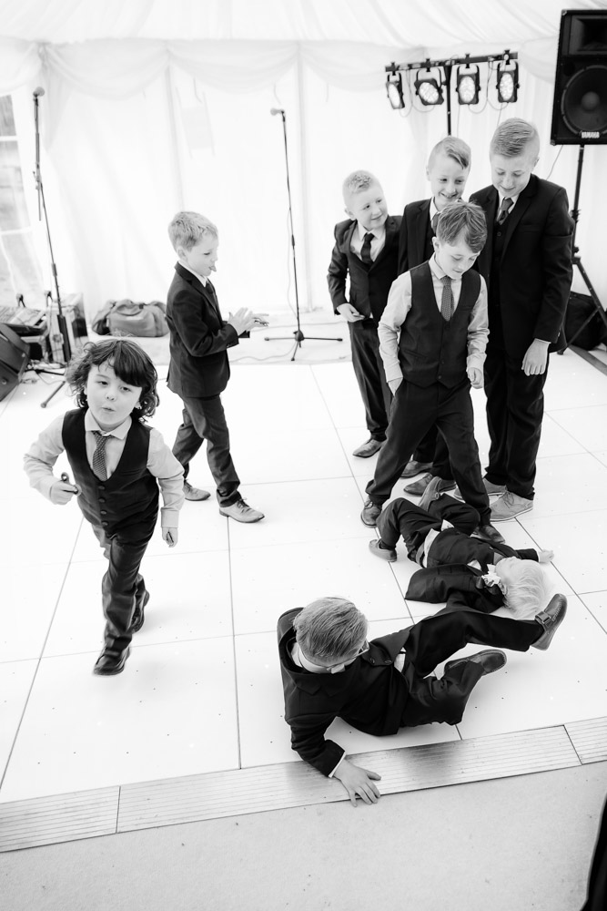 Boys tumble on the dancefloor
