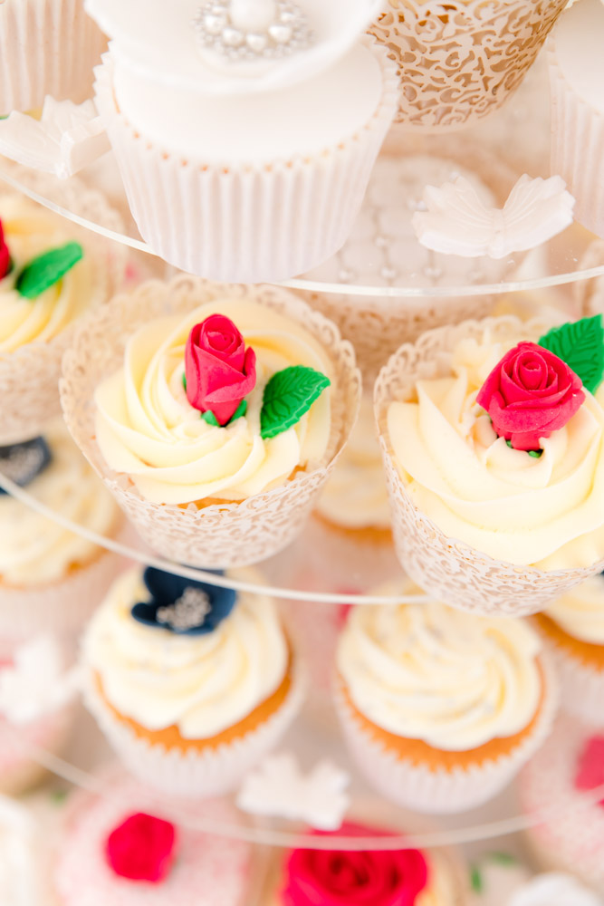 A close up photo of wedding cupcakes