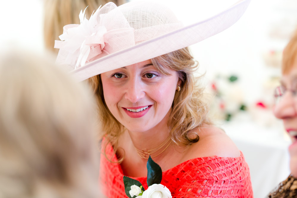 A guest smiles and chats during a wedding reception