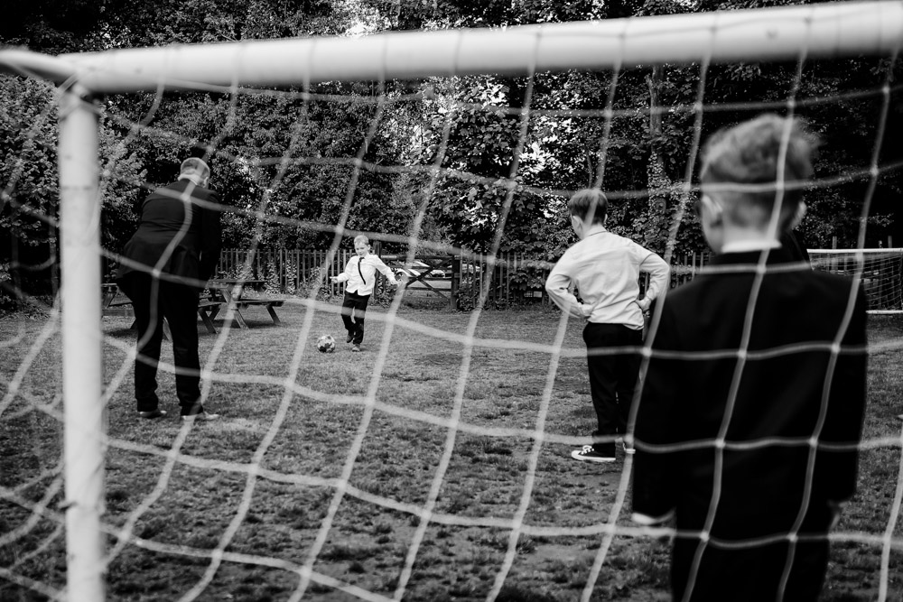 Football in the garden at a wedding