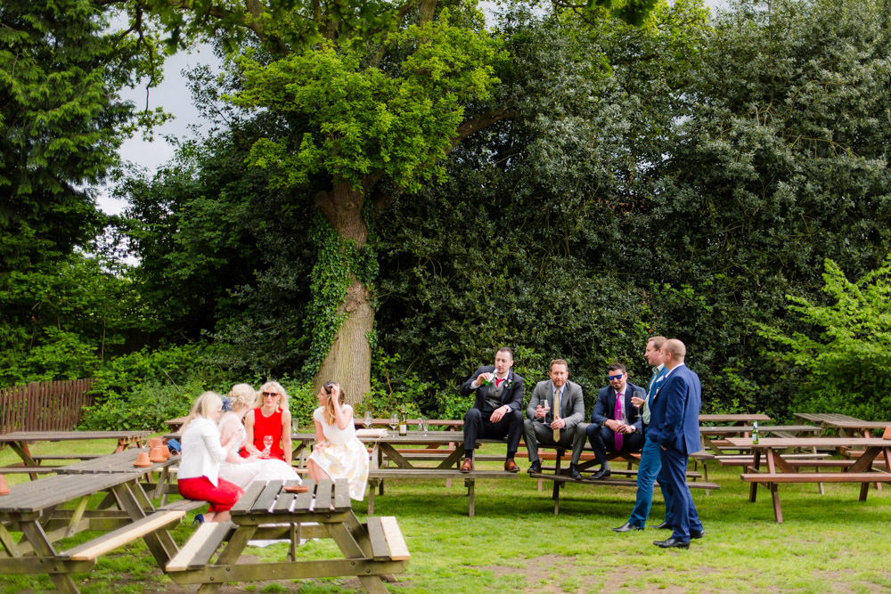 Wedding guests in a pub garden