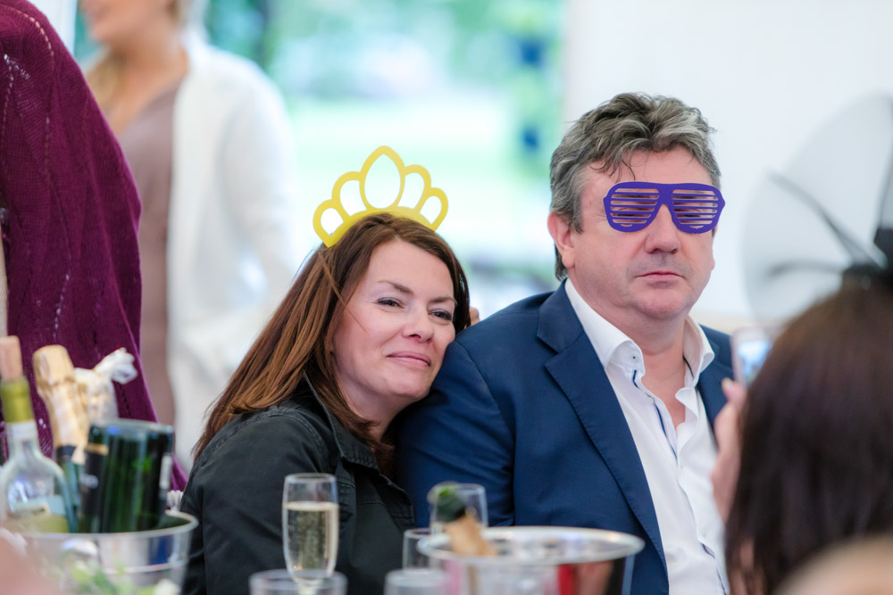 Wedding guests wearing silly glasses