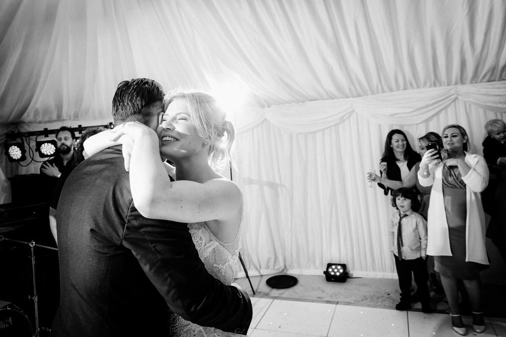 The bride and groom hug during the first dance