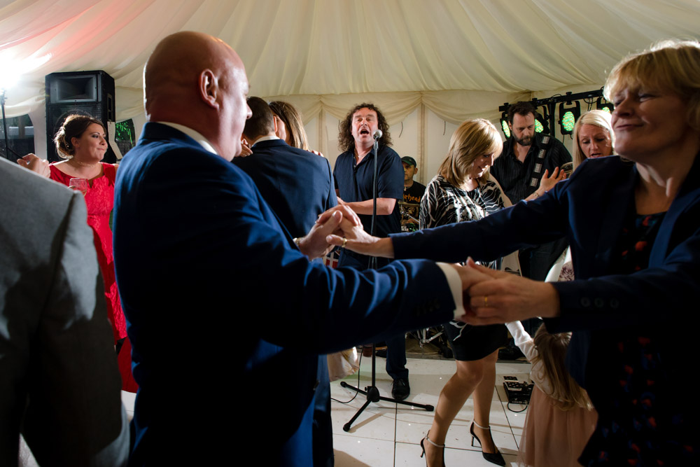 Guests dance as the band plays